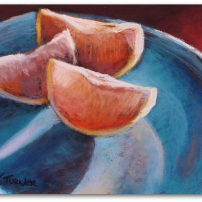 Pastel painting of three orange slices on blue plate by artist Vanessa Turner
