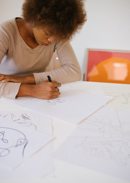 Woman working on Multiple art pieces simultaneously